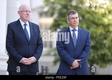 Justice Minister Charles Flannigan (left) at the announcement of Drew Harris (right) as the new Garda Commissioner at the government buildings in Dublin. - Stock Photo