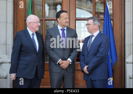 Taoiseach Leo Varadkar (centre)and Justice Minister Charles Flannigan (left) at the announcement of Drew Harris (right) as the new Garda Commissioner at the government buildings in Dublin. - Stock Photo