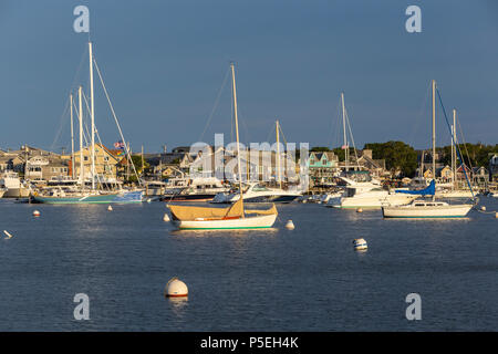 Sailboats and other pleasure craft moored in the harbor shortly before sunset in Oak Bluffs, Massachusetts on Martha's Vineyard. - Stock Photo