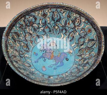 N/A. English: Exhibit in the Matsuoka Museum of Art - 5 Chome-12-6 Shirokanedai, Minato, Tokyo 108-0071, Japan. 20 February 2015, 00:16:58. Daderot 227 Bowl with design of equestrian figure, Iran, Minai type, 12th-13th century AD, enamel-painting over blue glaze pottery - Matsuoka Museum of Art - Tokyo, Japan - DSC07214 - Stock Photo