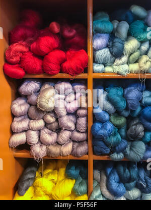 Asian traditional cultural color dyeing silk cloth process textile yarn thread fabric material in cabinet - Stock Photo
