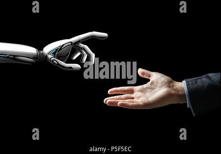 robot and human hand flash light over black - Stock Photo