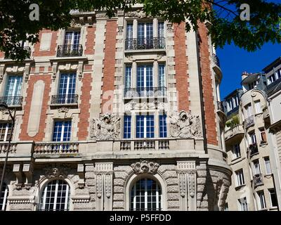 Front facade of red brick and limestone apartment building on rue guynemer, Paris, France - Stock Photo