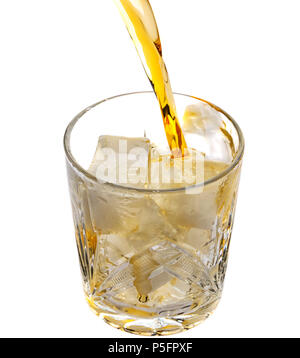 Pouring whiskey in an empty glass with ice.Top view - Stock Photo