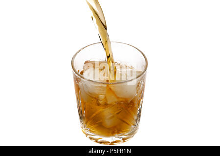 Pouring whiskey in a glass with ice. Top view - Stock Photo