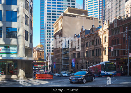 A view of Bridge Street from George Street in the early morning sun with traffic showing the old and new buildings of Sydney, NSW, Australia - Stock Photo