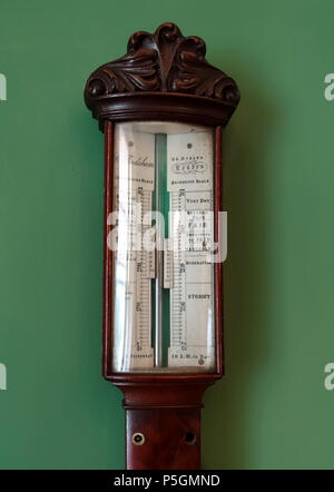 N/A. English: Object on display in Shugborough Hall - Staffordshire, England. 13 June 2016, 08:58:26. Daderot 172 Barometer by Charles Frodsham, view 2, London, date unknown, mahogany, mercury, metal, glass - Shugborough Hall - Staffordshire, England - DSC00451 - Stock Photo