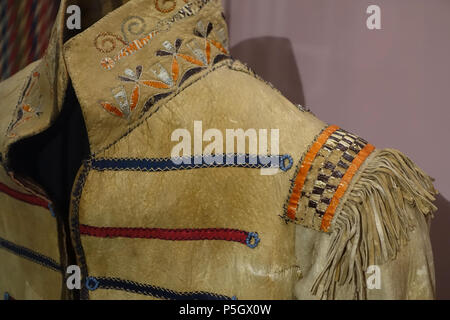 N/A. English: Exhibit from the Native American Collection, Peabody Museum, Harvard University, Cambridge, Massachusetts, USA. Photography was permitted without restriction; exhibit is old enough so that it is in the . 27 May 2017, 14:06:34. Daderot 536 European style coat, Iroquioian or Huron, detail, collected in 1839 - Native American collection - Peabody Museum, Harvard University - DSC05813 - Stock Photo