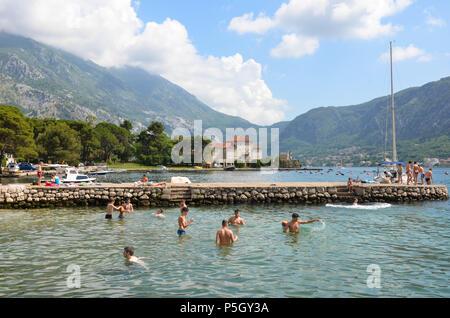 People swimming in the water, Kotor, Bay of Kotor, Montenegro - Stock Photo