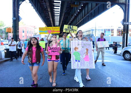 New York City, United States. 25th June, 2018. GSA takes lead in march. More than three hundred Queens residents, activists, political and community leaders responded to NY City Council Member for Queens Jimmy Van BramerÕs call to gather at St. SebastianÕs Church in Sunnyside, Queens, to rally and march on behalf of immigrant families who have been torn apart by WashingtonÕs policies regarding the treatment of illegal immigrants. Credit: Andy Katz/Pacific Press/Alamy Live News - Stock Photo