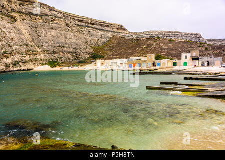 Colourful boat houses at Dwerja, the inland sea, Gozo, Malta. - Stock Photo