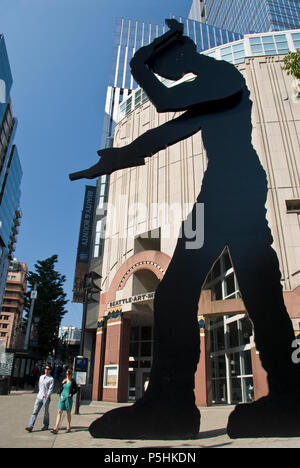 'Hammering Man' is a 48-feet-tall steel public artwork  by Jonathan Borofsky in front of the Seattle Art Museum. - Stock Photo