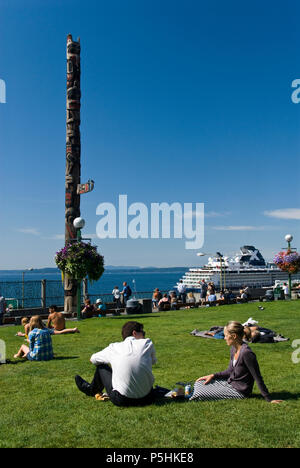 People enjoy a sunny day at Victor Steinbrueck Park, near Pike Place Market, in downtown Seattle, Washington. - Stock Photo