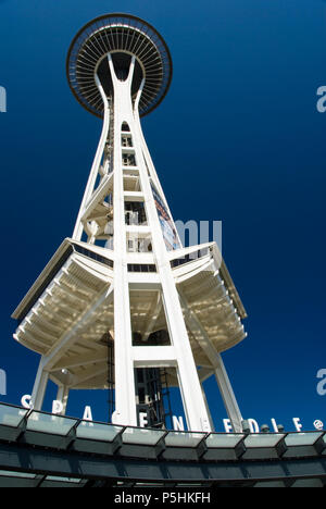 The Space Needle, located at the Seattle Center, was built for the 1962 World's Fair and has become the symbol of Seattle. - Stock Photo