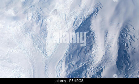 Aerial view of two valley glaciers meeting, Antarctica - Stock Photo