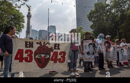 Relatives and supporters of the missing youth of Ayotzinapa march in the main avenues of Mexico City, Mexico, 26 June 2018. The parents of the 43 students of the school for teachers of Ayotzinapa disappeared in September 2014 expressed their confidence that the change of government in Mexico will advance the investigation and the case. EFE/MARIO GUZMAN - Stock Photo