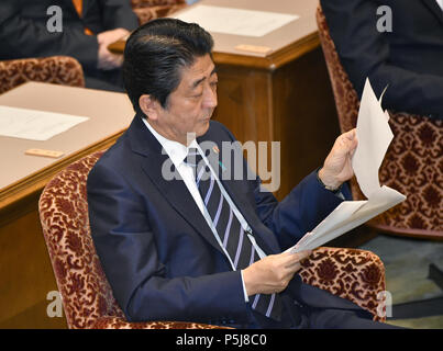 Tokyo, Japan. 27th June, 2018. Japan Prime Minister Shinzo Abe takes questions from Yukio Edano, leader of the Constitutional Democratic Party of Japan, during a Diet question time of the Joint Review Board of the Committee on Fundamental National Policies in Tokyo on Wednesday, June 27, 2018. Credit: Natsuki Sakai/AFLO/Alamy Live News - Stock Photo