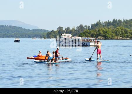 Luss, Loch Lomond, Scotland, UK - 27 June 2018: uk weather - Crowds flock to Luss to enjoy the beach and water sports as the temperature continues to rise Credit: Kay Roxby/Alamy Live News - Stock Photo