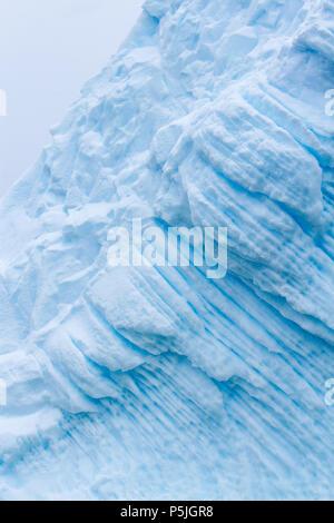 Iridescent blue iceberg detail, Antarctica - Stock Photo