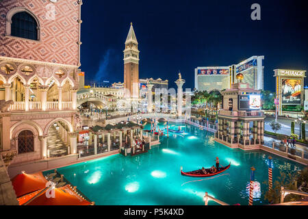 Downtown Las Vegas with world famous Strip and The Venetian and The Mirage Resort Hotels illuminated at night, Nevada - Stock Photo