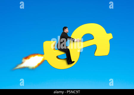 Sitting on money rocket in blue sky - Stock Photo