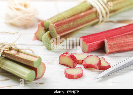 Fresh organic rhubarb on a white old wooden table. Selective focus,  copy space - Stock Photo