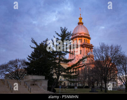 Illinois State Capitol building at sunrise with trees in Springfield Illinois - Stock Photo