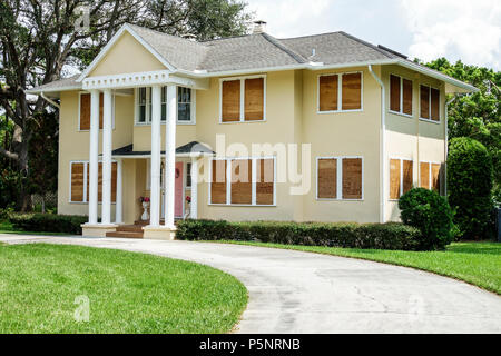 Fort Ft. Myers Florida Seminole Park Historic District McGregor Boulevard house home residence windows boarded up plywood Hurricane Irma - Stock Photo