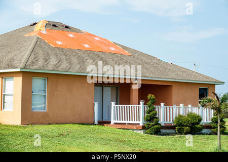Fort Ft. Myers Florida Lehigh Acres after Hurricane Irma storm wind damage destruction aftermath tarp waterproof covering roof house home residence ex - Stock Photo