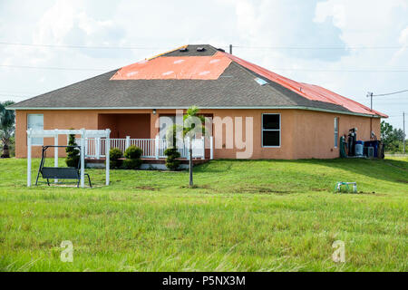 Fort Ft. Myers Florida Lehigh Acres after Hurricane Irma storm wind damage destruction aftermath tarp waterproof covering roof house home residence ba - Stock Photo