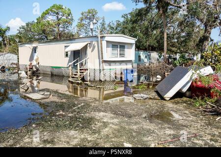 Bonita Springs Florida after Hurricane Irma storm rain damage destruction aftermath flooding mobile park trailer home debris trash stagnant water - Stock Photo