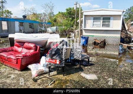 Bonita Springs Florida after Hurricane Irma storm rain damage destruction aftermath flooding mobile park trailer home debris trash stagnant water mold - Stock Photo