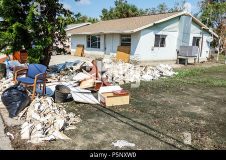 Bonita Springs Florida after Hurricane Irma storm water damage destruction aftermath flooding house home front yard debris trash pile flood depth wate - Stock Photo