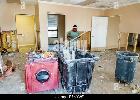 Bonita Springs Florida after Hurricane Irma storm damage destruction aftermath flooding business damaged drywall removed cleanup repair renovation His - Stock Photo
