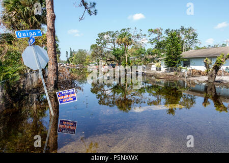 Bonita Springs Florida after Hurricane Irma storm rain damage destruction aftermath flooding house home residence neighborhood stagnant water - Stock Photo