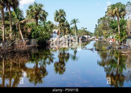 Bonita Springs Florida after Hurricane Irma wind rain damage destruction aftermath flooding house home residence neighborhood stagnant water - Stock Photo