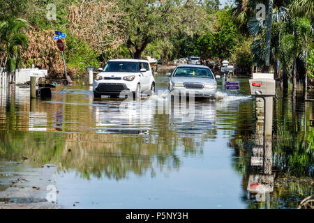 Bonita Springs Florida after Hurricane Irma wind rain damage destruction aftermath flooding house home residence neighborhood stagnant water moving ca - Stock Photo
