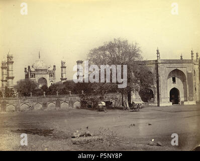 N/A. English: This photograph was taken in the 1860s for the Allardyce Collection. It shows the Bibi-ka-Maqbara or Queen's Tomb (1678), the most famous building in Aurangabad. After the death of his wife Rabia Durani in 1657, the Mughal Emperor Aurangzeb (reigned 1658-1707) ordered his son Azam Shah to build a mausoleum for her. It was designed by the architect Ata Aula as an imitation on a reduced scale of the Taj Mahal at Agra. Lack of funds meant that it fell short of the original plan. The mausoleum is situated in the centre of a walled enclosure with a garden surrounded by a crenellated w - Stock Photo