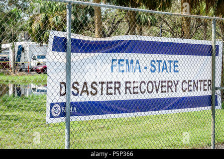 Immokalee Florida FEMA State Disaster Recovery Center centre storm assistance relief fence banner - Stock Photo