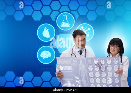 Two doctors discussing x-ray image in telemedicine concept - Stock Photo