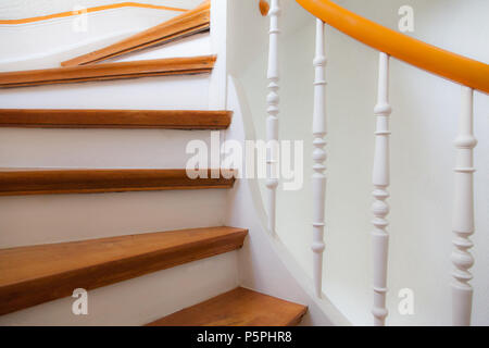 ältere Frau geht die Treppe hinauf mit Stock, elderly Person on stairs with stick - Stock Photo
