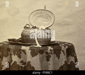 N/A. English: Close up view of the table in File:Portrait of an unidentified Indian woman in the 1860s.jpg . 1860s. Shivashanker Narayen 228 Box-vintage-photograph - Stock Photo