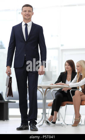 portrait of a practising lawyer in the background of the office. business people - Stock Photo