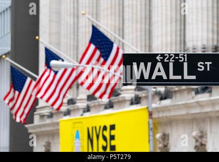 Wall Street sign near New York Stock Exchange - Stock Photo