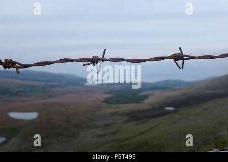 Fenced Views over looking Dingle Peninsula from Conor Pass ( Connor Pass ). County Kerry, Ireland. - Stock Photo