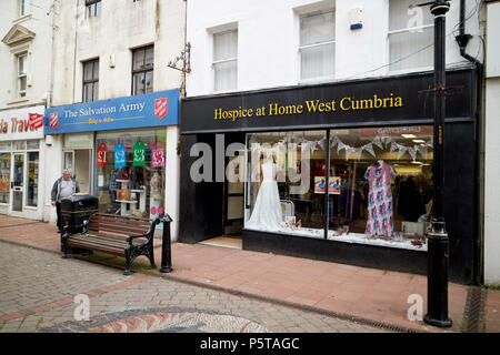 High street charity shops in main shopping area of Whitehaven Cumbria England UK - Stock Photo