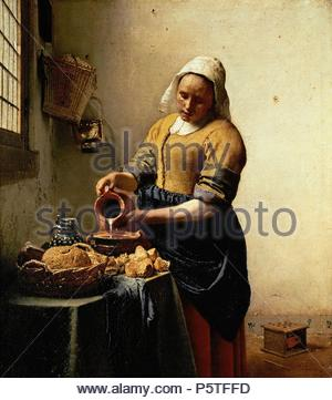 Johannes Vermeer / 'The Milkmaid', 1660-1661, Oil on canvas, 44.5 x 41 cm. Artwork also known as: LA LECHERA. Museum: Rijksmuseum. - Stock Photo