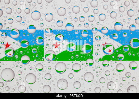 Flags  of Djibouti behind a glass covered with raindrops. - Stock Photo