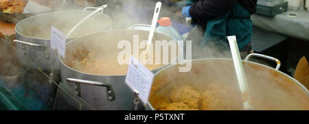 Delicious Steaming hot street food at the weekly Broadway Street Market, Hackney, London, England, Europe. - Stock Photo