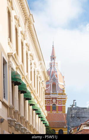 A street in the historic centre of Cartagena showing the cupola and tower of San Pedro Claver church - Stock Photo